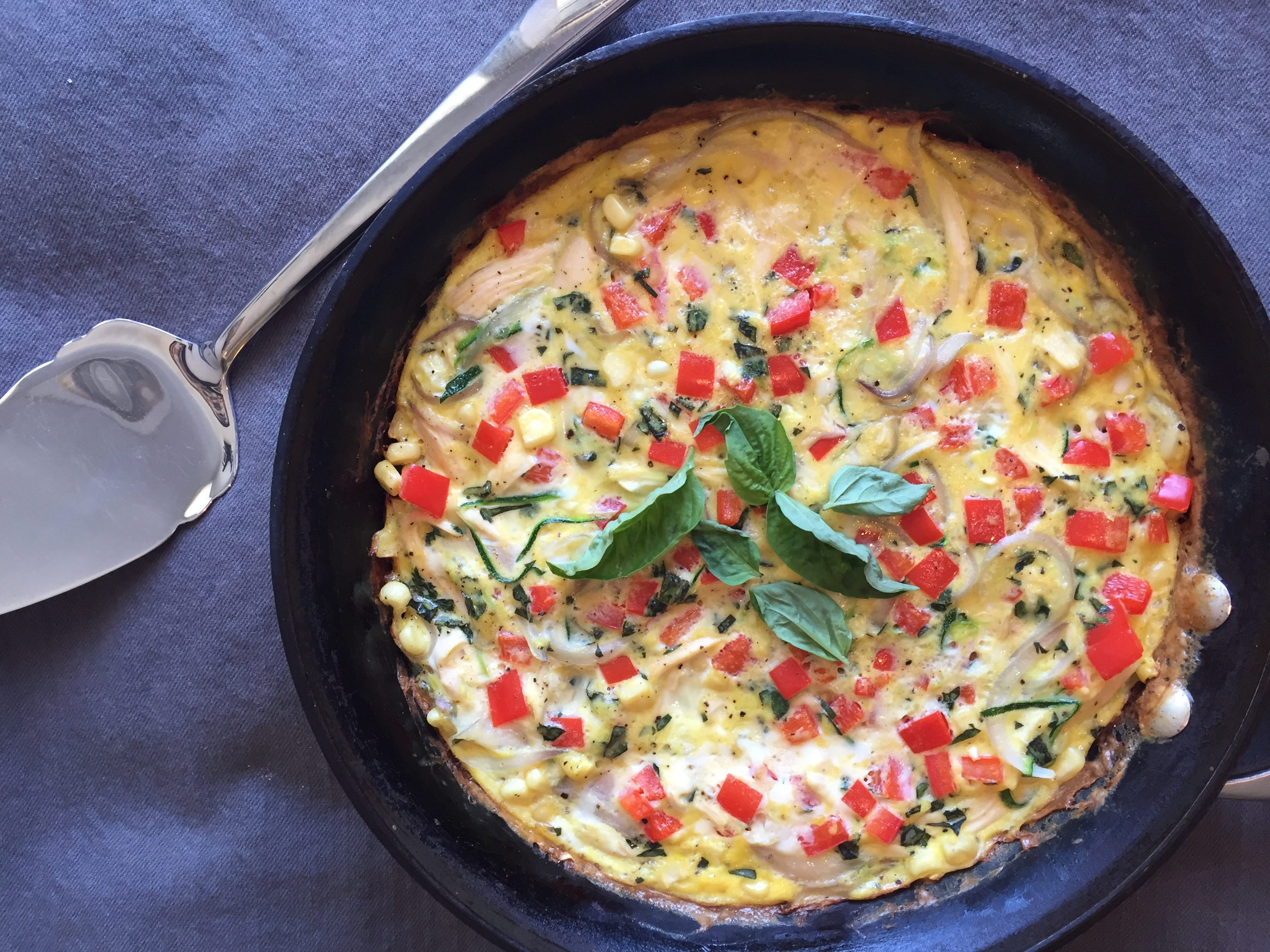 Chicken-basil vegetable frittata with zucchini, bell peppers, and sweet summer corn